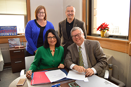 Pictured: KU Provost Neeli Bendapudi signs MOU to extend the Academic Health Department with Lawrence-Douglas County Health Department to 2020.